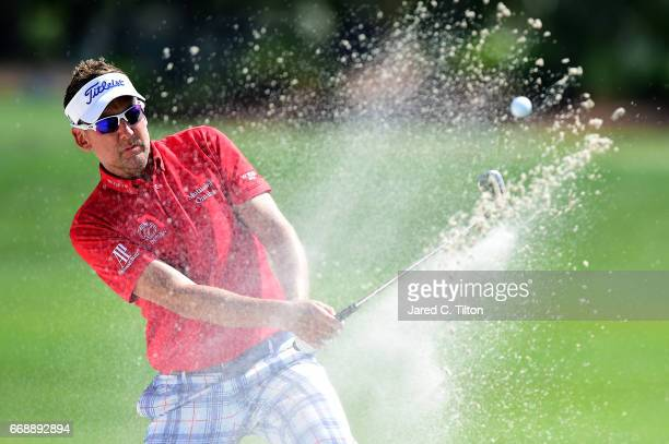 Ian Poulter of England plays his second shot from the bunker on the ninth hole during the third round of the 2017 RBC Heritage at Harbour Town Golf...