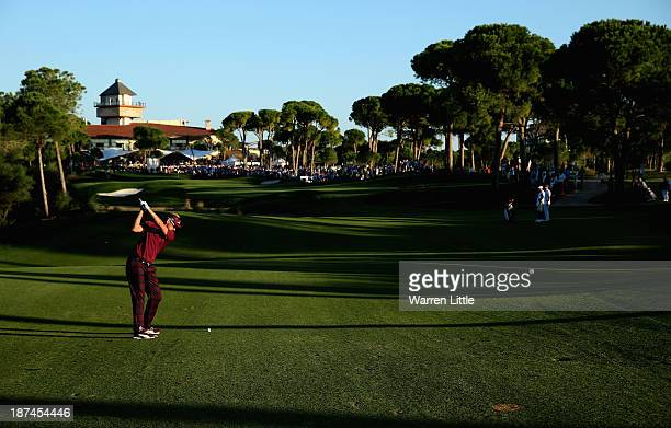 Ian Poulter of England plays his second shot into the 18th green during the third round of the Turkish Airlines Open at The Montgomerie Maxx Royal...
