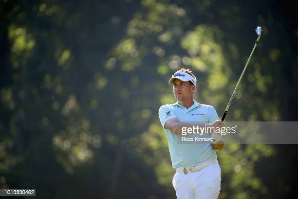 Ian Poulter of England plays his shot from the 13th tee during the first round of the 2018 PGA Championship at Bellerive Country Club on August 9...