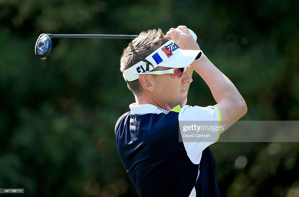 Ian Poulter of England plays his tee shot at the par 3, fourth hole wearing a visor coloured with the French flag in remembrance of the Paris terrorist attacks last week during the first round of the 2015 DP World Tour Championship on the Earth Course at Jumeirah Golf Estates on November 19, 2015 in Dubai, United Arab Emirates.
