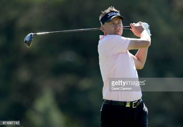 Ian Poulter of England plays his tee shot on the sixth hole during the first round of the 2018 US Open at Shinnecock Hills Golf Club on June 14 2018...