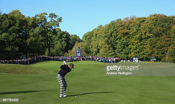 Ian Poulter of England plays his third shot on the 15th hole during the first round of the British Masters supported by Sky Sports at Woburn Golf...
