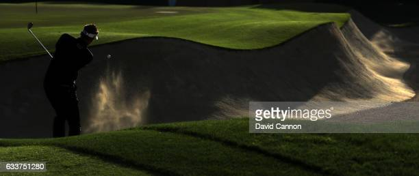 Ian Poulter of England plays his third shot on the par 5, 10th hole during the completion of the weather delayed second round of the 2017 Omega Dubai...