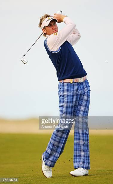 Ian Poulter of England plays to the 18th green during the third round of The Alfred Dunhill Links Championship at Kingsbarns Golf Links on October 6,...