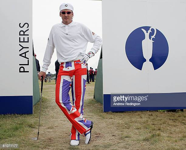 Ian Poulter of England poses on the practice range in union jack trousers prior to beginning his game during the first round of the 133rd Open...