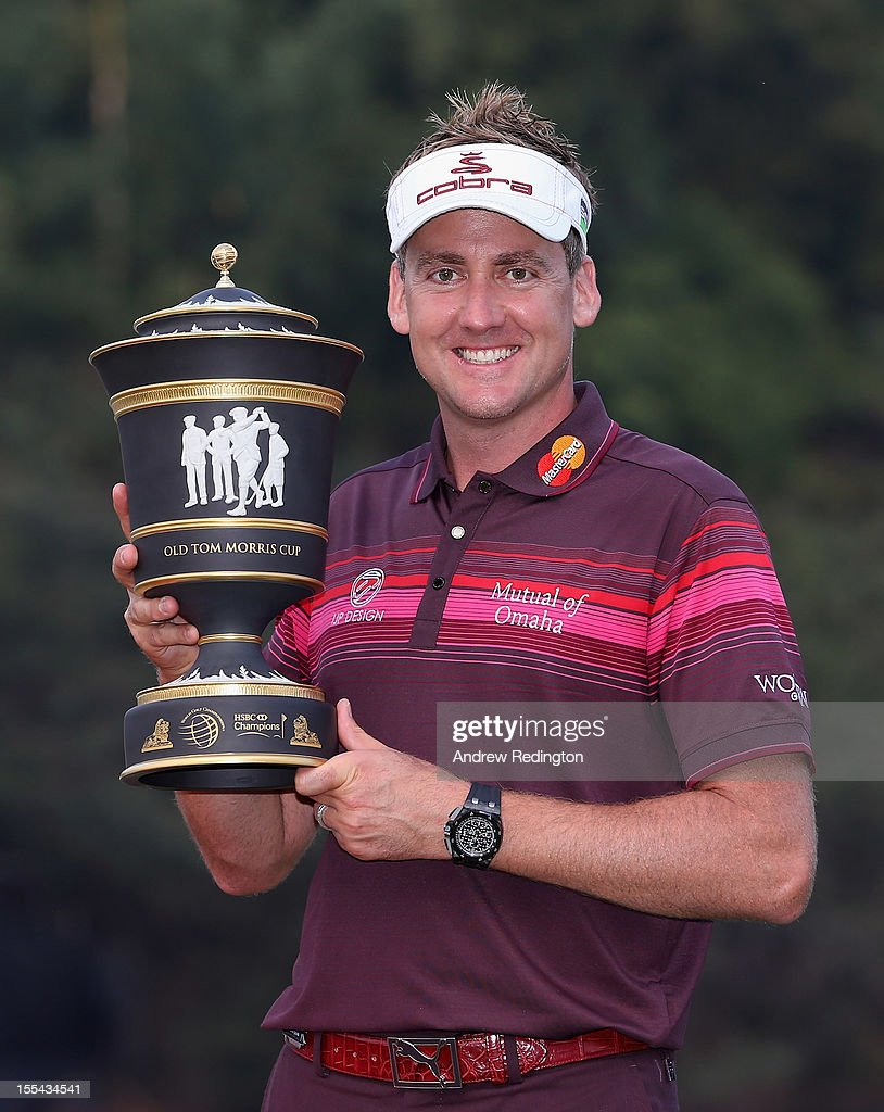 Ian Poulter of England poses with the trophy after winning the WGC HSBC Champions during the final round at the Mission Hills Resort on November 4, 2012 in Shenzhen, China.