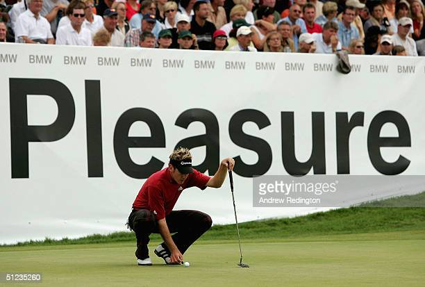 Ian Poulter of England prepares to putt for eagle on the 18th hole during the final round of the BMW International Open at Eichenried Golf Club on...