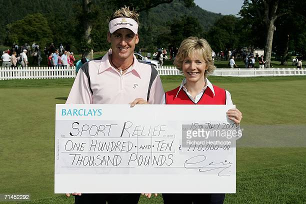 Ian Poulter of England presents a cheque for GBP110000 to Hazel Irvine of the BBC for the Sport Relief charity during the third round of The Barclays...