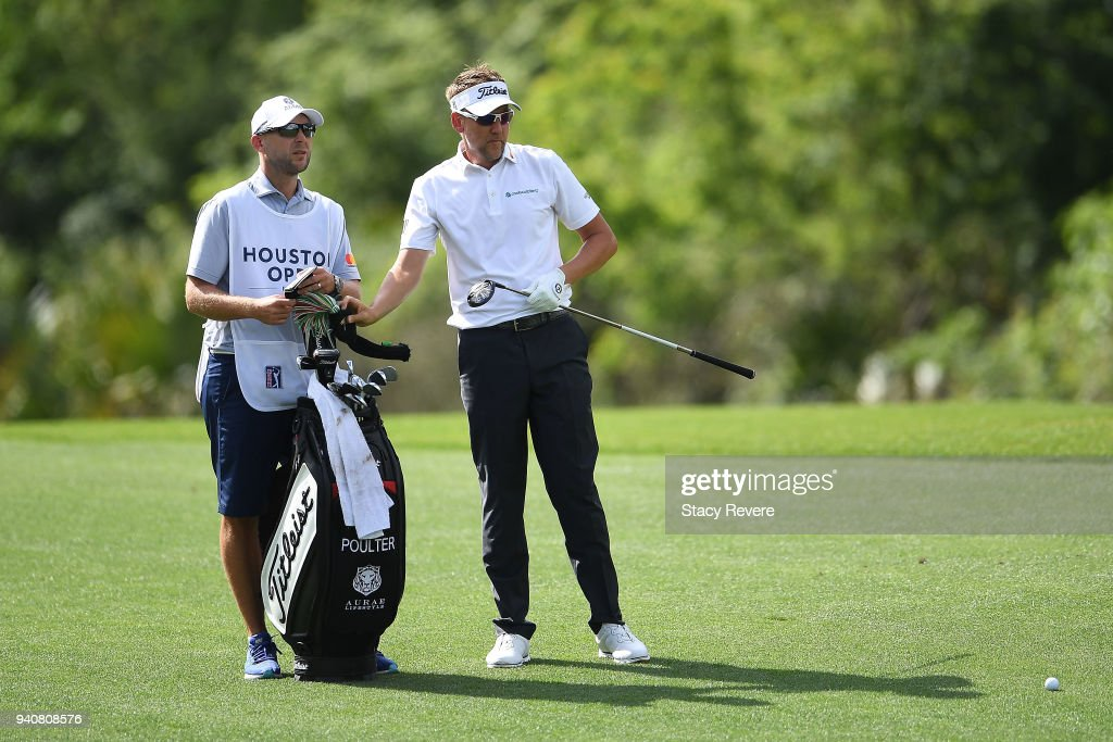 Ian Poulter of England pulls a club from his bag on the 15th hole during the final round of the Houston Open at the Golf Club of Houston on April 1, 2018 in Humble, Texas.