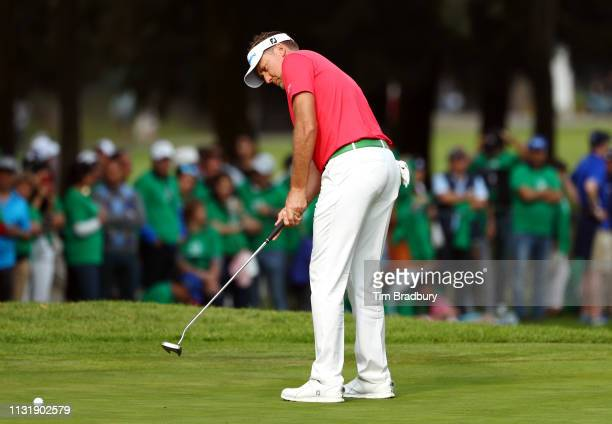 Ian Poulter of England putts on the 18th green during the final round of World Golf ChampionshipsMexico Championship at Club de Golf Chapultepec on...