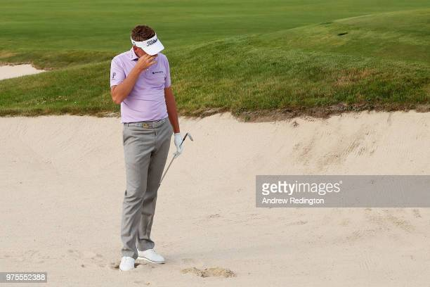 Ian Poulter of England reacts after playing his third shot on the eighth hole during the second round of the 2018 US Open at Shinnecock Hills Golf...