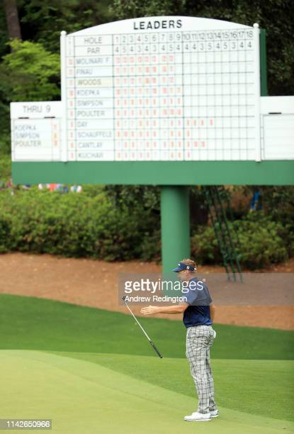 Ian Poulter of England reacts on the 10th hole during the final round of the Masters at Augusta National Golf Club on April 14 2019 in Augusta Georgia