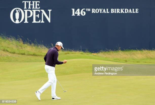 Ian Poulter of England reacts on the 18th green during the first round of the 146th Open Championship at Royal Birkdale on July 20 2017 in Southport...