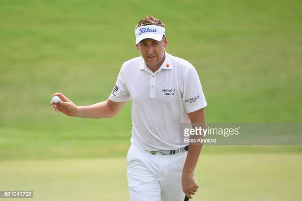 Ian Poulter of England reacts to his putt on the first green during the final round of the 2017 PGA Championship at Quail Hollow Club on August 13...