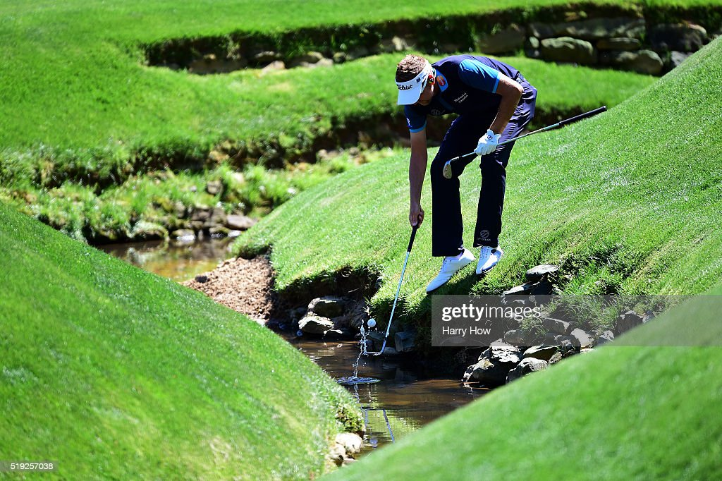 Ian Poulter of England retrieves his ball out of Rae's Creek during a practice round prior to the start of the 2016 Masters Tournament at Augusta National Golf Club on April 5, 2016 in Augusta, Georgia.