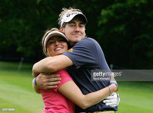 Ian Poulter of England shares a joke with ProAm team partner Jo Gasiorowska during the BMW Championship 2005 ProAm Event at the Wentworth Club on May...