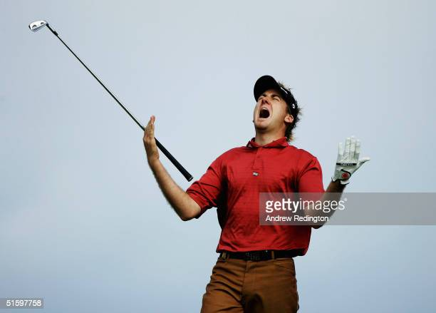 Ian Poulter of England shows his frustration after hitting his second shot on the 16th hole during the first round of the 2004 Volvo Masters at the...