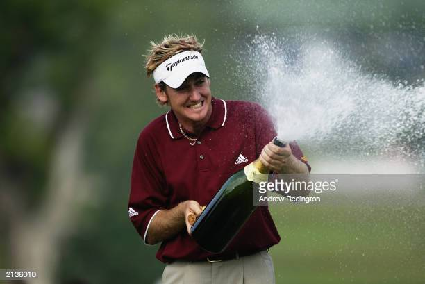 Ian Poulter of England sprays champagne after winning the Wales Open on June 1 2003 at the Celtic Manor Hotel and Golf Resort in Newport Wales