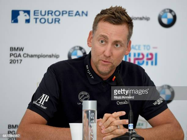 Ian Poulter of England talking Thorbjorn Olesen of Denmark the press during a practice round prior to the BMW PGA Championship at Wentworth on May 23...
