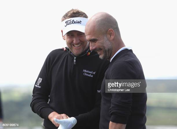 Ian Poulter of England talks to Manchester City manager Pep Guardiola during the ProAm of the Dubai Duty Free Irish Open at Portstewart Golf Club on...