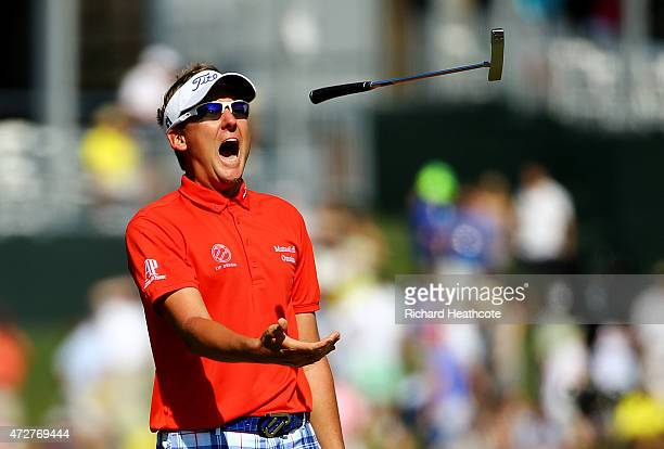 Ian Poulter of England throws his putter after missing a putt on the 17th green during round three of THE PLAYERS Championship at the TPC Sawgrass...