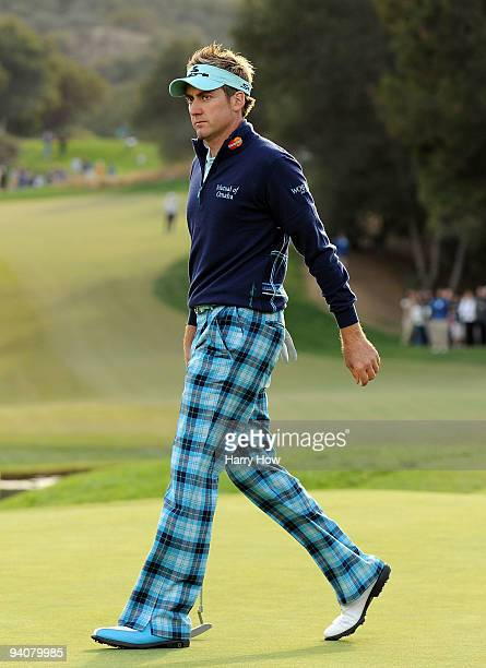 Ian Poulter of England walks off the 18th green during the fourth round of the Chevron World Challenge at Sherwood Country Club on December 6, 2009...
