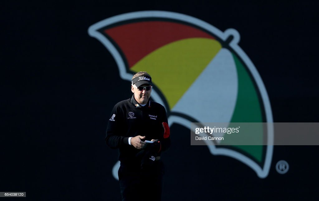 Ian Poulter of England walks past the Arnold Palmer umbrella logo after his tee shot on the par 4, 18th hole during the first round of the 2017 Arnold Palmer Invitational presented by MasterCard on March 16, 2017 in Orlando, Florida.