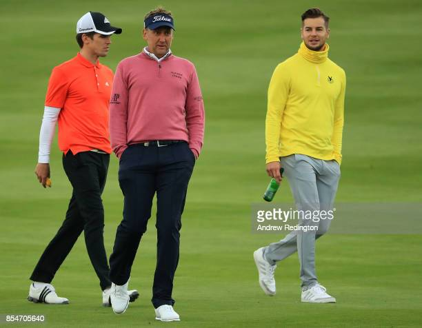 Ian Poulter of England walks with TV personalities Gary Beadle and Chris Hughes during the pro am ahead of the British Masters at Close House Golf...