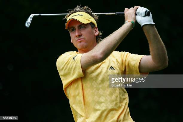 Ian Poulter of England watches a tee shot during the second practice round of the 2005 PGA Championship at Baltusrol Golf Club on August 9, 2005 in...