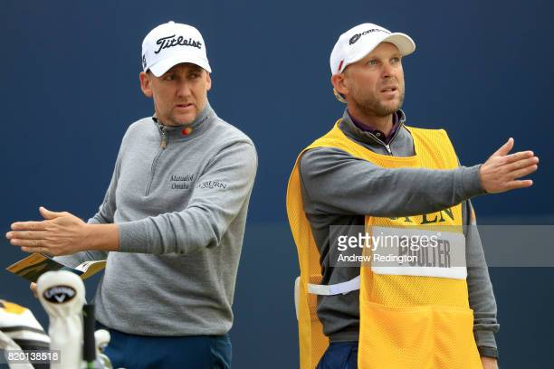Ian Poulter of England with his caddie on the 1st tee during the second round of the 146th Open Championship at Royal Birkdale on July 21 2017 in...