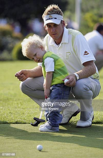 Ian Poulter of England with his son Luke, aged 2 on the putting green after the first round of The Quinn Direct British Masters being played on the...