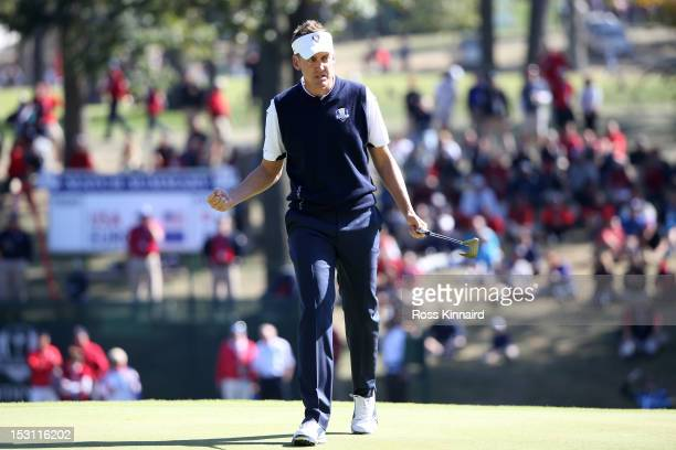 Ian Poulter of Europe celebrates a birdie putt on the 12th hole during the Singles Matches for The 39th Ryder Cup at Medinah Country Club on...