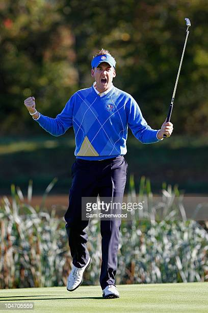 Ian Poulter of Europe celebrates a birdie putt on the third green in the singles matches during the 2010 Ryder Cup at the Celtic Manor Resort on...