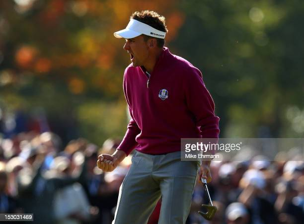 Ian Poulter of Europe celebrates a putt during day two of the Morning Foursome Matches for The 39th Ryder Cup at Medinah Country Club on September 29...