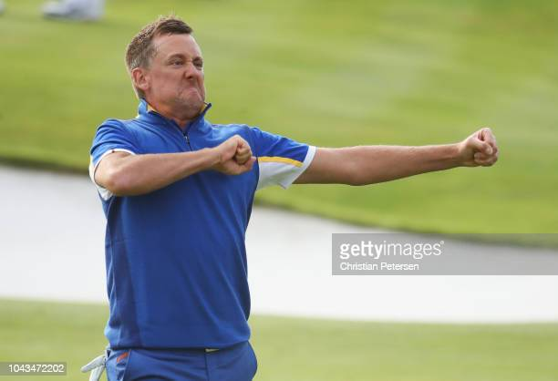 Ian Poulter of Europe celebrates winning his match on the 18th during singles matches of the 2018 Ryder Cup at Le Golf National on September 30 2018...