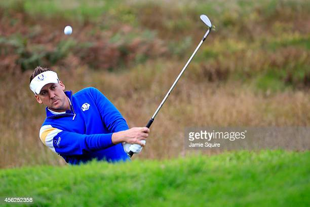 Ian Poulter of Europe chips on the 1st hole during the Singles Matches of the 2014 Ryder Cup on the PGA Centenary course at the Gleneagles Hotel on...