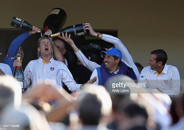 Ian Poulter of Europe is drenched in champagne on the balcony of the clubhouse following Europe's victory during the 2010 Ryder Cup at the Celtic...
