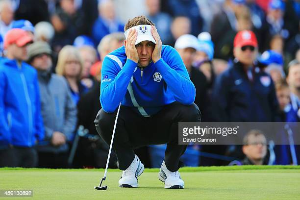 Ian Poulter of Europe lines up a putt on the 13th green during the Morning Fourballs of the 2014 Ryder Cup on the PGA Centenary course at the...