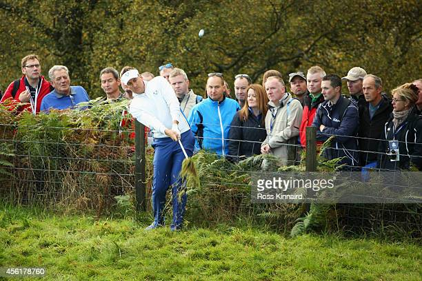 Ian Poulter of Europe plays his third shot on the 5th hole during the Morning Fourballs of the 2014 Ryder Cup on the PGA Centenary course at the...