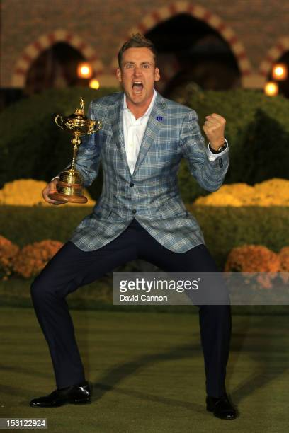 Ian Poulter of Europe poses with the Ryder Cup after Europe defeated the USA 145 to 135 to retain the Ryder Cup during the Singles Matches for The...