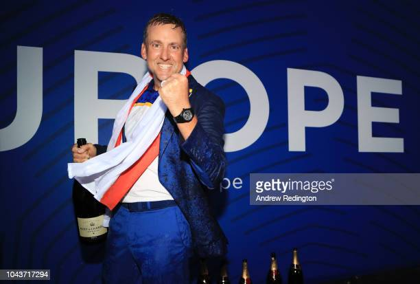 Ian Poulter of Europe sprays champagne as he celebrates after winning The Ryder Cup following the singles matches of the 2018 Ryder Cup at Le Golf...