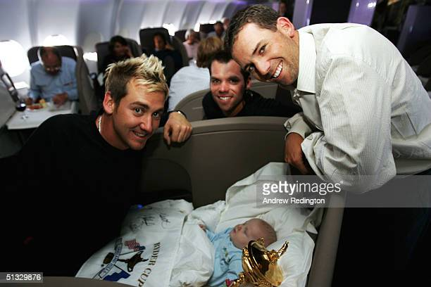 Ian Poulter, Paul Casey, and Sergio Garcia of the victorious European Ryder Cup team, pose with Ian Poulter's son Luke and the Ryder Cup during the...