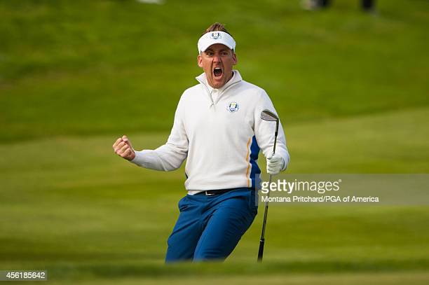 Ian Poulter reacts to holing his shot from the bunker on fifteen during the fourball matches for the 40th Ryder Cup at Gleneagles on September 27...