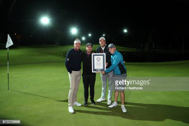 Ian Poulter Tyrrell Hatton Matthew Southgate and Matthew Fitzpatrick celebrate setting a new Guiness World Record for the fastest hole of golf at the...