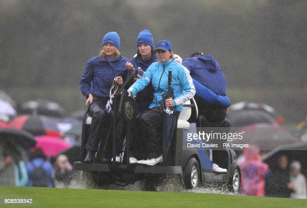 Ian Poulter's wife Katie Poulter and Ross Fisher's wife Jo Fisher take a ride on a golf buggy during the friday fourball round
