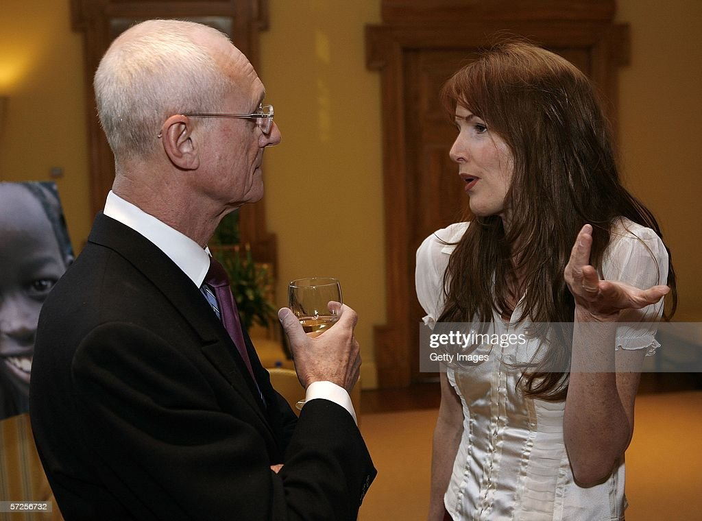 Ian Ralfini (L) of Manhattan/EMI Records speaks with singer Bird York during a reception held at the MPAA by Friends of the Global Fight April 4, 2006, in Washington, DC.