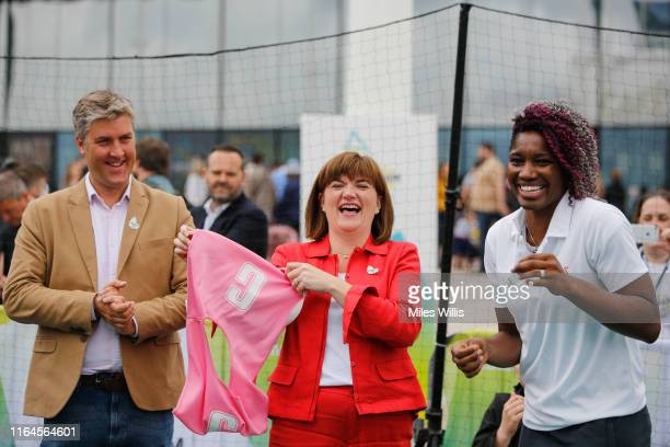 Ian Reid CEO Birmingham 2022 Commonwealth Games laughs with Nicky Morgan Secretary of State for Digital Culture Media and Sport and Netball athlete...