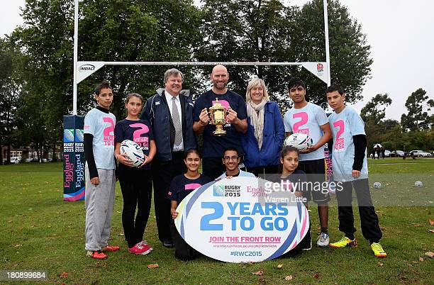 Ian Ritchie CEO of RFU Lawrence Dallaglio and Debbie Jevans England Rugby 2015 CEO pose with the Webb Ellis Cup flanked by local children after a...