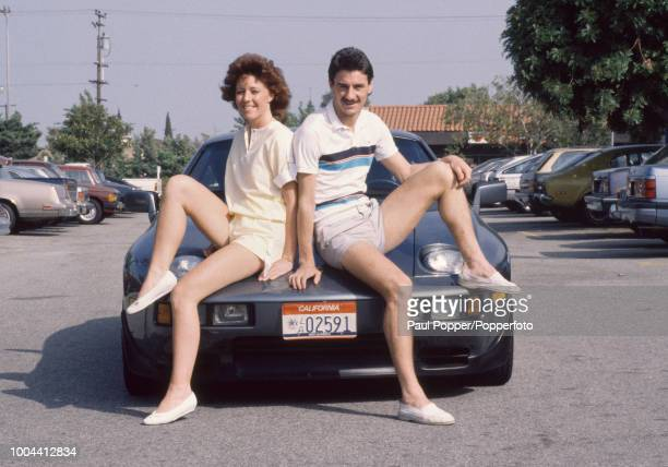 Ian Rush sits on a Porsche with girlfriend Tracy Evans while on holiday in California, United States, circa July 1984.