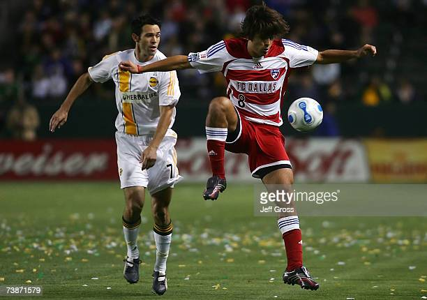 Ian Russell of the Los Angeles Galaxy watches play as Juan Toja of FC Dallas jumps to control the ball during their MLS match at Home Depot Center on...